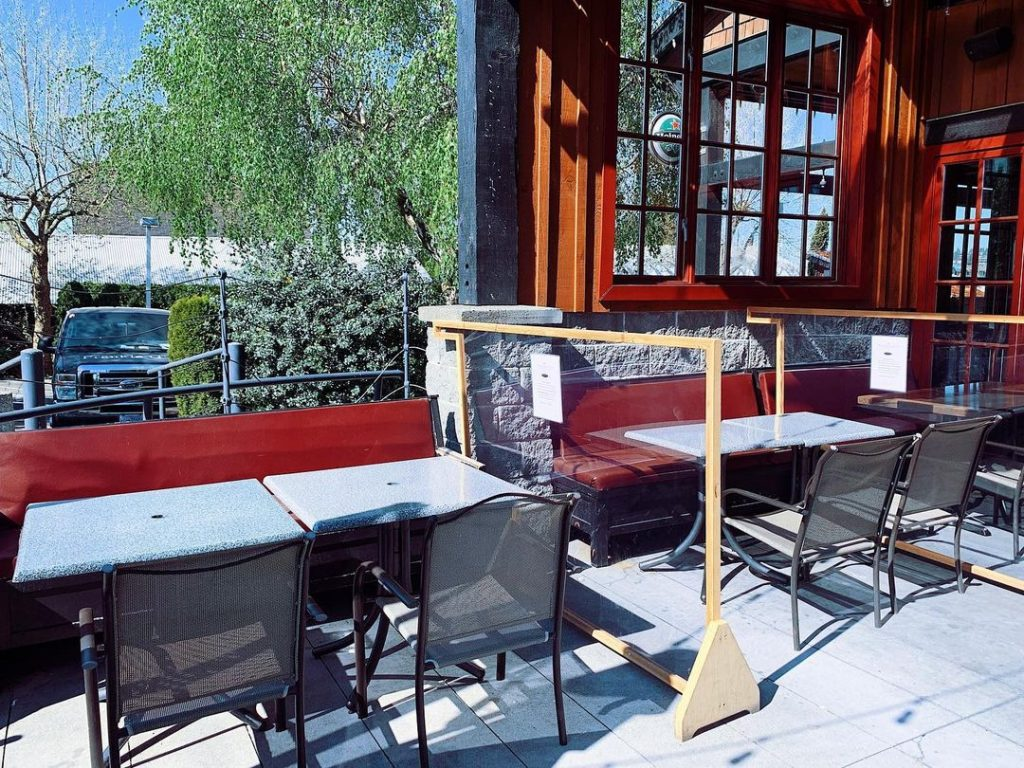 An outdoor patio with tables and chairs