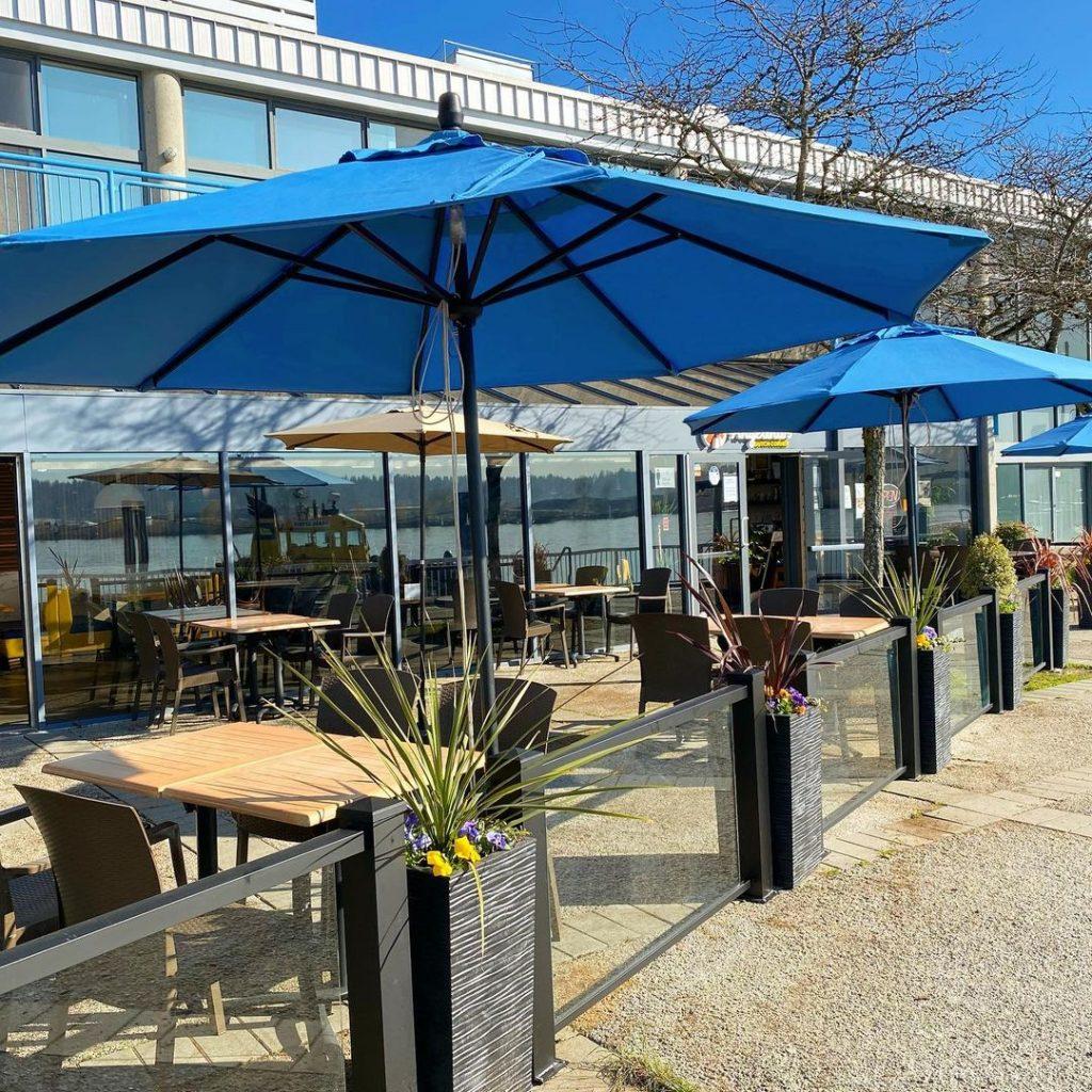 An outdoor patio with blue umbrellas