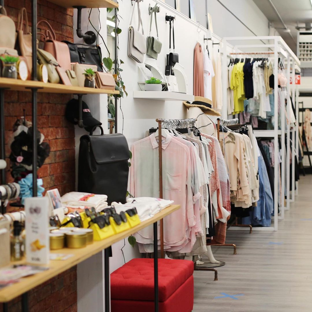 Walls of clothing and merchandise in a women's fashion boutique.