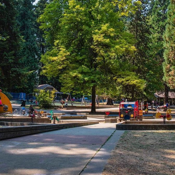 A shaded walking path and playground.